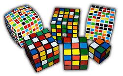 Variasi dari rubik, dari kiri atas (searah jarum jam): V-Cube 7, Professor's Cube, V-Cube 6, Pocket Cube,Kubus Rubik Original, Rubik Revenge.