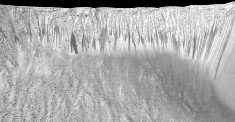 Dark narrow streaks, up to a few hundred yards long, are seen along many slopes on Mars including Garni Crater. The identification of waterlogged salts in these streaks fits with the idea that they are formed by the underground flow of briny water that wets the surface. - Jet Propulsion Laboratory/University of Arizona/NASA